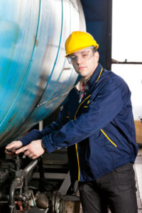 maintenance technician fixing equipment